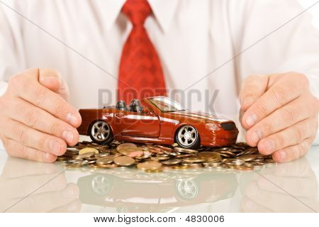 Businessman With Red Toy Car