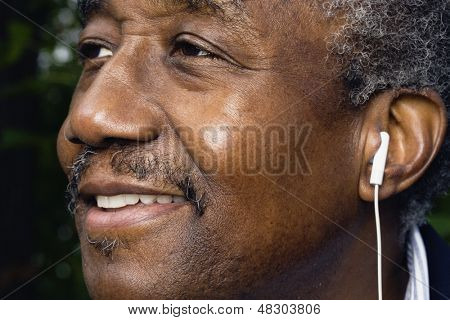 Close up of senior man with earphones