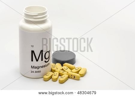 Open bottle of Magnesium vitamins