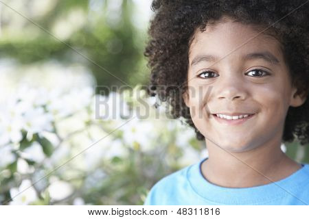 Closeup portrait of cute boy smiling outdoors