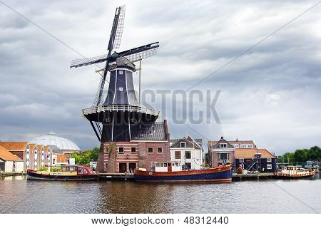 Picturesque landscape with windmill. Haarlem