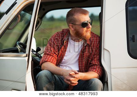 Driver Sits In His Truck Cab