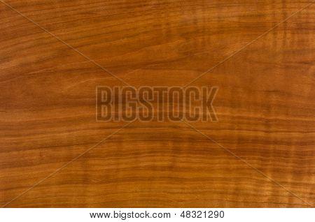 closeup shot of an antique cherry wood table