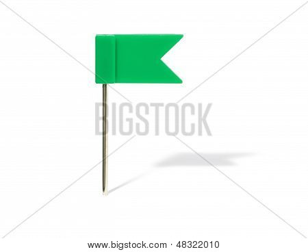 Green flag pin with shadow on a white background