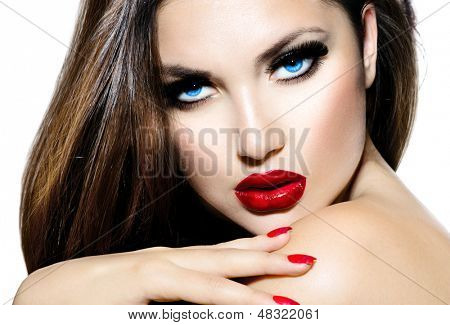 Picture or Photo of Sexy Beauty Girl with Red Lips and Nails. Provocative Make up. Luxury Woman with Blue Eyes. Fashion Brunette Portrait isolated on a white background. Gorgeous Woman Face. Long Hair