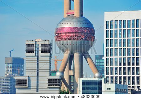 SHANGHAI, CHINA - MAY 27: Oriental Pearl Tower over river on May 27, 2012 in Shanghai, China. The tower was the tallest structure in China excluding Taiwan from 1994-2007 and the landmark of Shanghai.