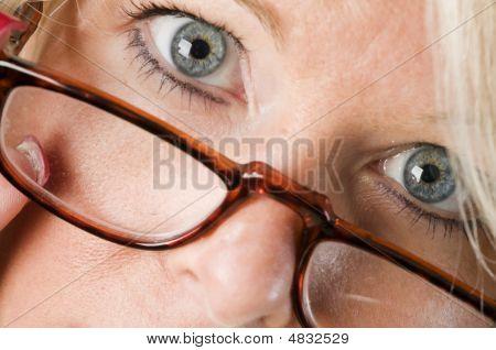 Pretty Attractive Blond Woman Close Up Reading Glasses