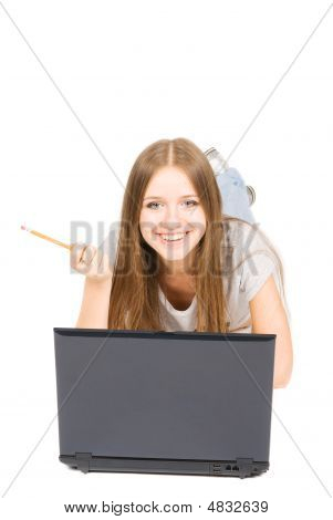 Pretty Girl With Pencil And Laptop