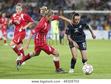 MADRID, SPAIN. 16/05/2010. Potsdam's DF Bianca Schmidt and Olympique's MF Aur���©lie Kaci in action during the Women's Champions League final  played in the Coliseum Alfonso Perez, Getafe, Madrid.