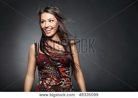 beautiful young girl on dark background