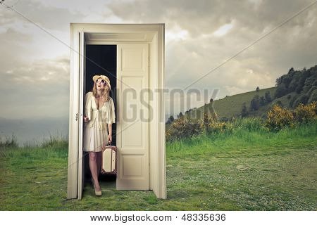 beautiful tourist opens a magic door