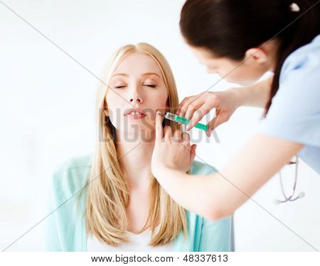healthcare, medical and plastic surgery - beautician with patient doing botox injection in hospital