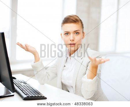 business concept - stressed businesswoman with computer in office