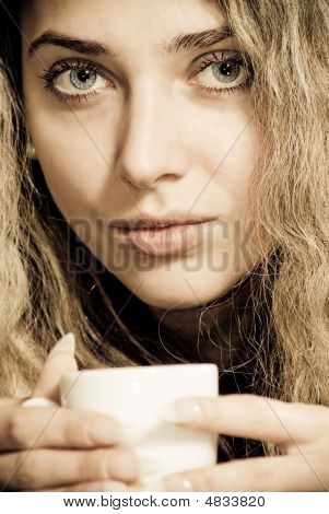Close-up Portrait Of Beautiful Woman Drinking Coffee