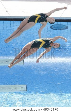 ROME, ITALY - JULY 24 2009; Rome Italy; Briony Cole and Sharlen Stratton competing in the women's synchronised 3m diving at the 13th Fina World Aquatics Championships held in the The Foro Italico Swimming Complex.