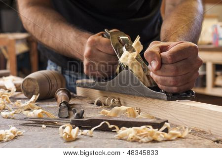 Carpenter Working  With  Plane