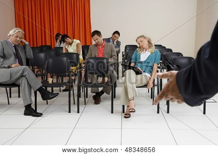 Multiethnic businesspeople sleeping during a seminar in conference room