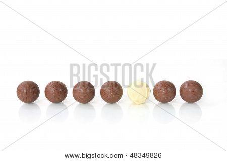 white chocolate among brown ones