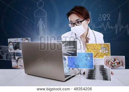 Beautiful Doctor Writing Prescription With Digital Pictures