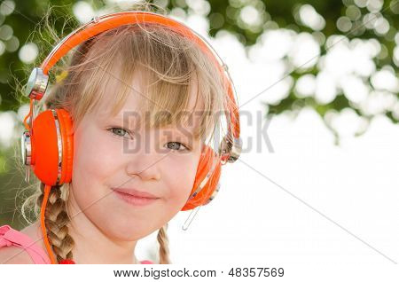 Closeup Portrait Of Cheerful Girl Listening Lesson