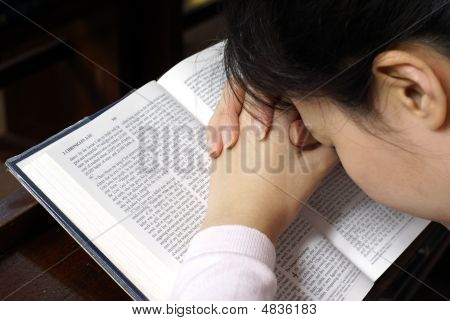 Lady Praying On Her Bible
