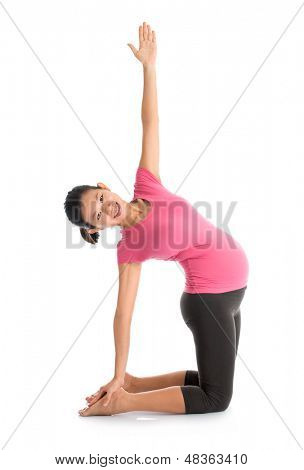 Prenatal yoga meditation. Full length healthy Asian pregnant woman doing yoga exercising stretching at home, full body isolated on white background.