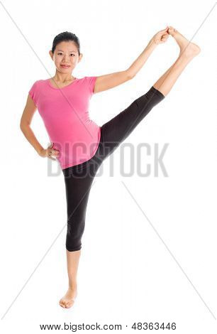 Prenatal exercise. Full length healthy Asian pregnant woman doing pilates exercise stretching at home, full body isolated on white background.