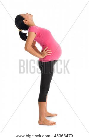 Prenatal yoga. Full length healthy Asian pregnant woman doing yoga exercise stretching at home, full body isolated on white background. Yoga positions standing back bend.