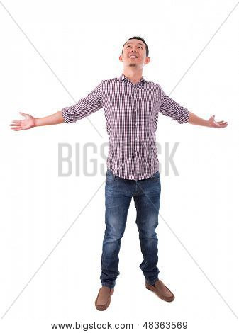 Happy Asian man arms opened looking up. Full body standing isolated on white background. Asian male model.