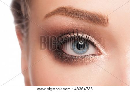 Close-up image of beautiful woman blue eye with bright makeup