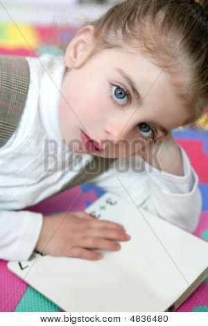 Beautiful Preschooler Girl Studying Book