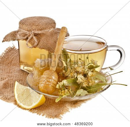 linden honey and  tea cup in sackcloth isolated on white background