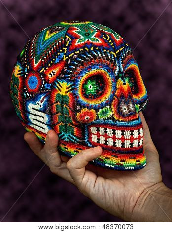 Colorful Beaded Skull on Hand