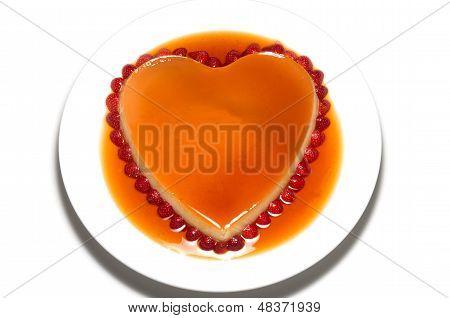 Heart Shape Flan Caramel On White Background
