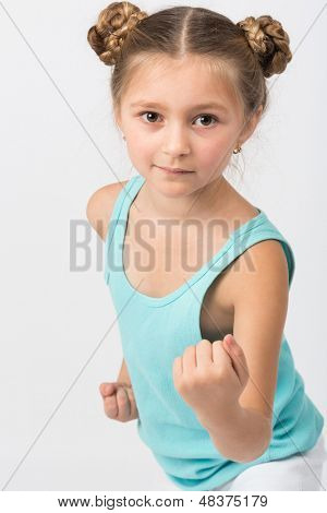 Portrait of a girl in a fighting stance