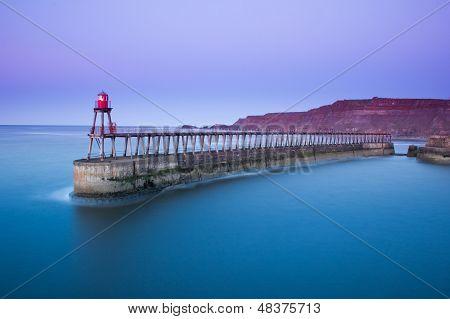 Whitby pier at dusk