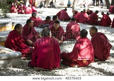 LHASA, TIBET- OCT 07: Tibetan monks are debating over Buddhist Scriptures at the Sera Monastery on October 07, 2011 in Lhasa, Tibet.
