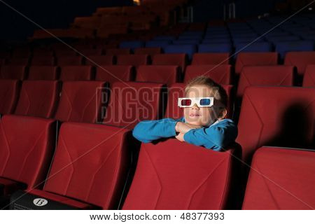 Little boy watching a movie in 3D glasses