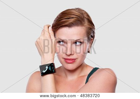 Girl With A Modern Internet Smart Watch On Grey Background