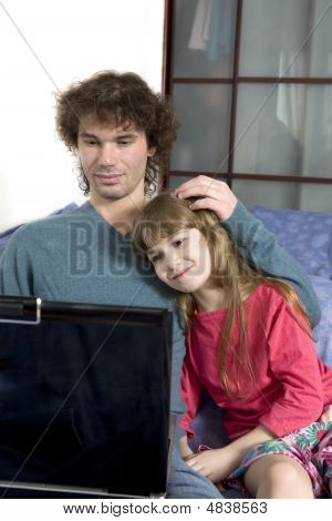 Father And Daughter Playing Game