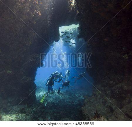 Scuba Divers In An Underwater Cavern