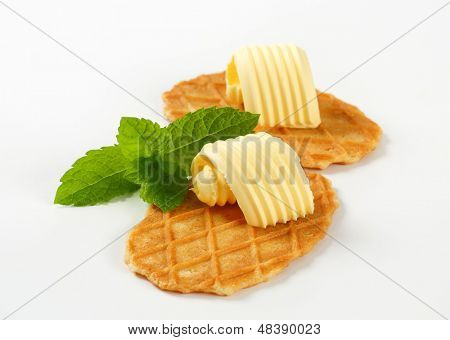 wafers with butter curl and leaf of mint