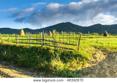 Wooden fence sticks in a village in the mountains