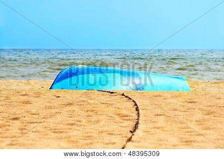 Overturned Boat On The Sandy Seashore.