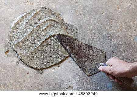 trowel with wet concrete