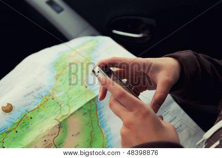 Woman Hands Using A Mobile Navigation App