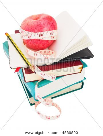 Apple With Measure Tape On Big Pile Of Books_0055