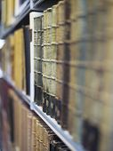 foto of shelving unit  - Closeup of antique books in a row on shelf - JPG