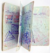 old open passport with lots of visas