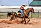 stock photo of western saddle  - Western horse and rider competing in pole bending and barrel racing competition - JPG